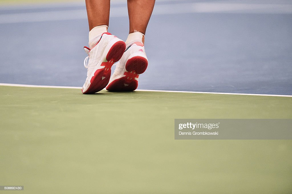 <a gi-track='captionPersonalityLinkClicked' href=/galleries/search?phrase=Angelique+Kerber&family=editorial&specificpeople=4307332 ng-click='$event.stopPropagation()'>Angelique Kerber</a> of Germany serves in her match against Belinda Bencic of Switzerland on Day 2 of the 2016 FedCup World Group Round 1 match between Germany and Switzerland at Messe Leipzig on February 7, 2016 in Leipzig, Germany.