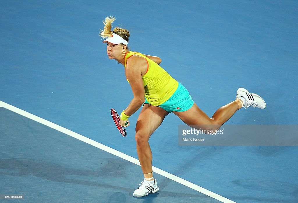 Angelique Kerber of Germany serves in her quarter final match against Svetlana Kuznetsova of Russia during day four of the Sydney International at Sydney Olympic Park Tennis Centre on January 9, 2013 in Sydney, Australia.