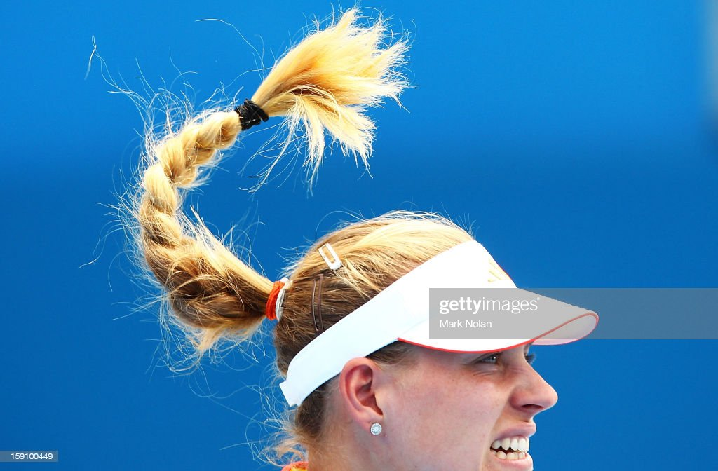 Angelique Kerber of Germany serves in her round two match against Galina Voskoboeva of Kazakhstan during day three of Sydney International at Sydney Olympic Park Tennis Centre on January 8, 2013 in Sydney, Australia.