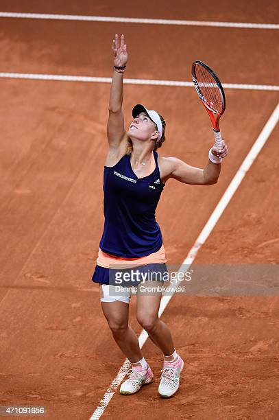 Angelique Kerber of Germany serves in her semi final match against Madison Brengle of the United States during Day 6 of the Porsche Tennis Grand Prix...