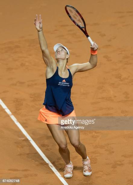 Angelique Kerber of Germany serves the ball to Kristina Mladenovic of France during the Porsche Tennis Grand Prix at Porsche Arena in Stuttgart...