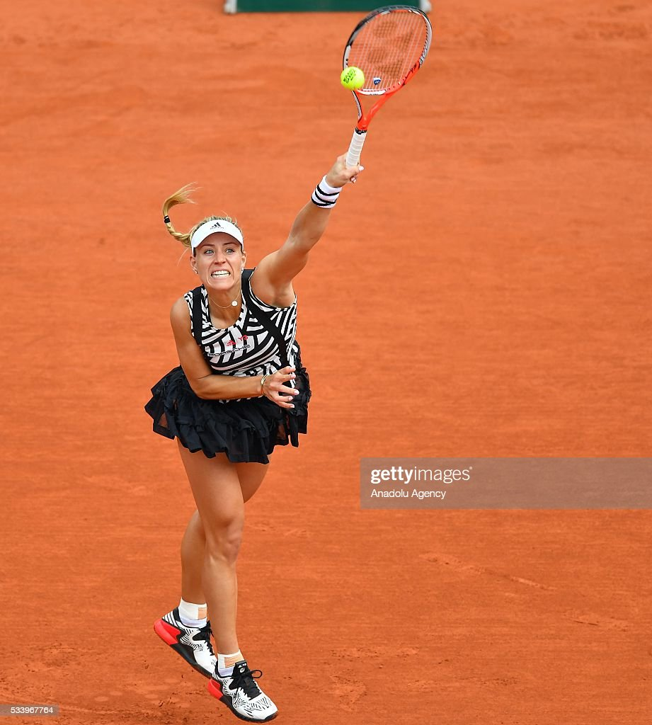 Angelique Kerber of Germany serves to Kiki Bertens of the Netherlands during their women's single first round match at the French Open tennis tournament at Roland Garros in Paris on May 24, 2016.