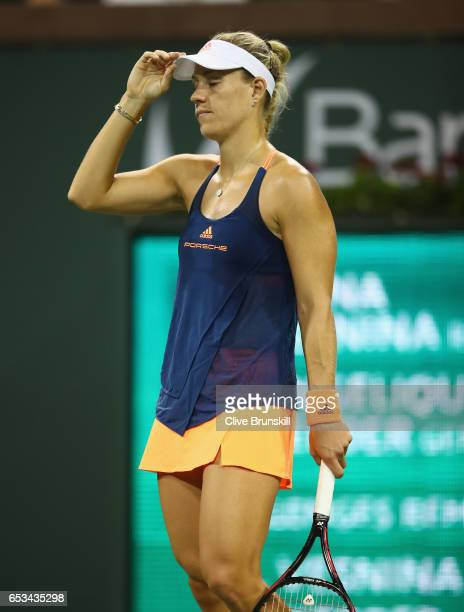 Angelique Kerber of Germany shows her dejection during her straight set defeat by Elena Vesnina of Russia in their fourth round match during day nine...