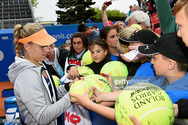 Angelique Kerber of Germany signs autographs after her match against Klara Koukalova of Czech Republic during Day Four of the Nuernberger...