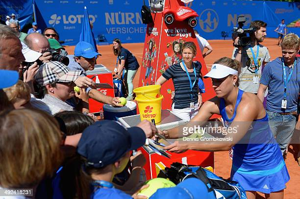 Angelique Kerber of Germany signs autographs after her match against Marina Erakovic of New Zealand during Day 4 of the Nuernberger Versicherungscup...