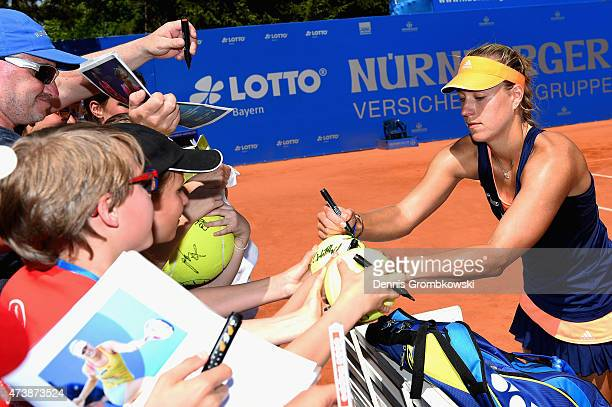 Angelique Kerber of Germany signs autographs after her victory in her match against Rebecca Peterson of Sweden during Day Three of the Nuernberger...