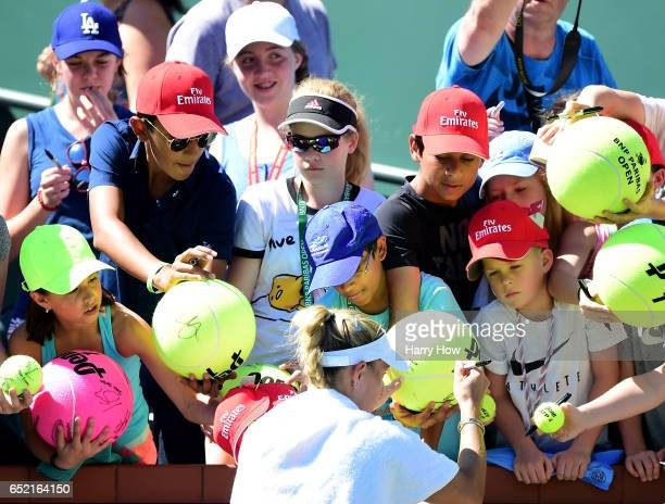 Angelique Kerber of Germany signs autographs for fans after her straight set win over Andrea Petkovic of Germany at Indian Wells Tennis Garden on...