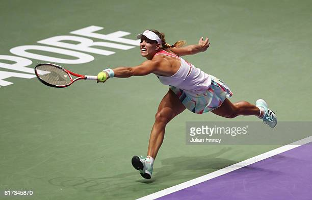Angelique Kerber of Germany stretches for a backhand in her singles match against Dominika Cibulkova of Slovakia during day 1 of the BNP Paribas WTA...