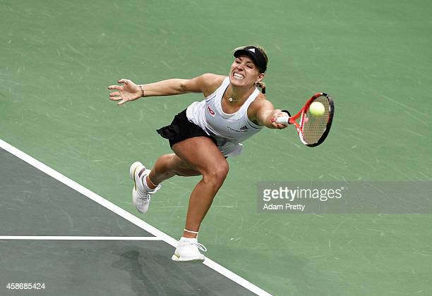 Angelique Kerber of Germany stretches for a forehand during the third rubber of the Fed Cup Final between Petra Kvitova of the Czech Republic and...