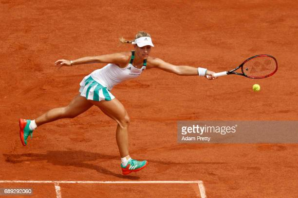 Angelique Kerber of Germany stretches to hit a forehand during the ladies singles first round match against Ekaterina Makarova of Russia on day one...
