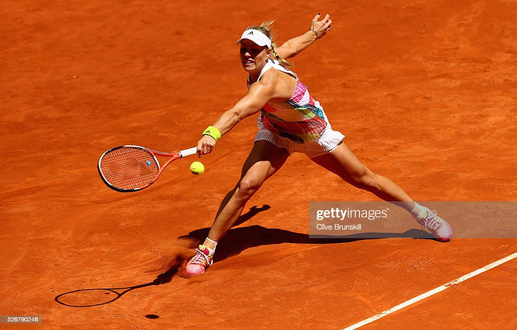 <a gi-track='captionPersonalityLinkClicked' href=/galleries/search?phrase=Angelique+Kerber&family=editorial&specificpeople=4307332 ng-click='$event.stopPropagation()'>Angelique Kerber</a> of Germany stretches to play a backhand against Barbora Strycova of the Czech Republic in their first round match during day two of the Mutua Madrid Open tennis tournament at the Caja Magica on May 01, 2016 in Madrid,Spain
