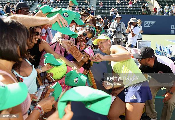Angelique Kerber of Germany takes a selfie with a fan after she beat Karolina Pliskova of the Czech Republic in the finals on Day 7 of the Bank of...
