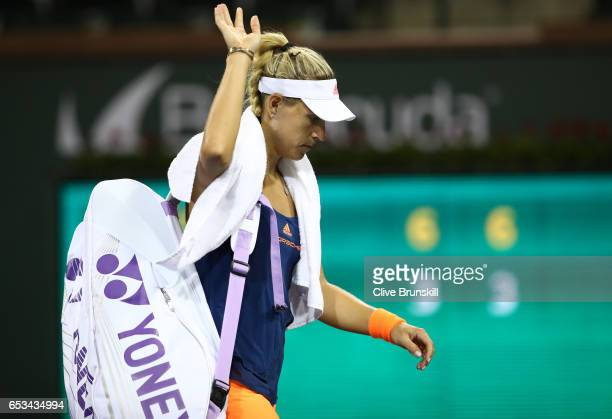 Angelique Kerber of Germany walks off the court after her straight set defeat by Elena Vesnina of Russia in their fourth round match during day nine...