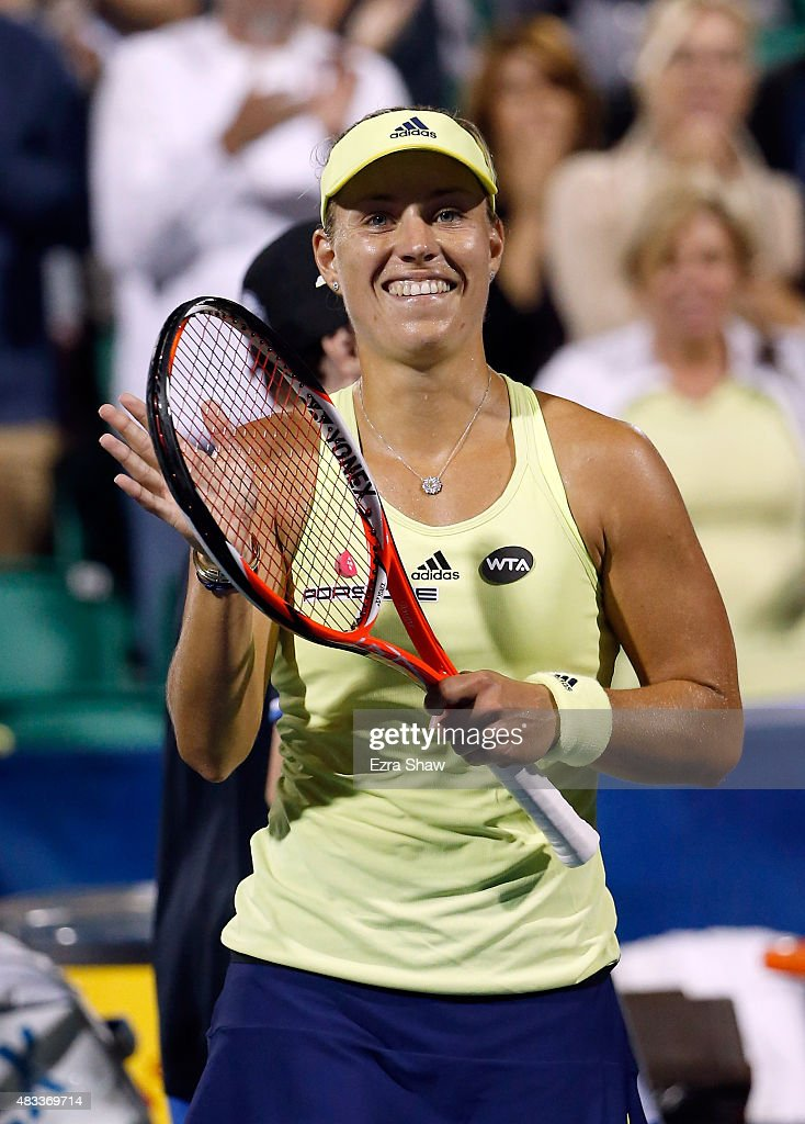 Angelique Kerber of Germany waves to the crowd after beating Agnieszka Radwanska of Poland during Day 5 of the Bank of the West Classic at Stanford University Taube Family Tennis Stadium on August 7, 2015 in Stanford, California.