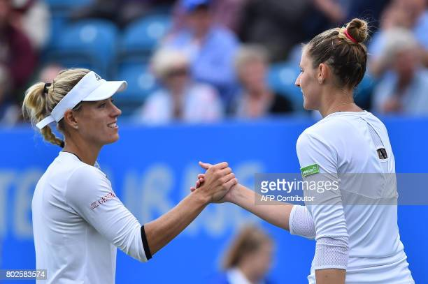 Germany's Angelique Kerber shakes hands with Czech Kristina Pliskova after their women's singles round two tennis match at the ATP Aegon...