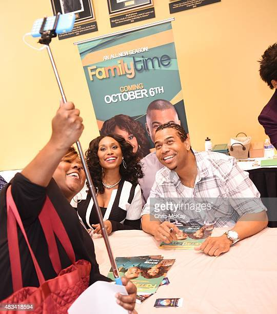 Angell Conwell and Omar Gooding of the Bounce TV series Family Time poses for a selfie with a fan at Georgia World Congress Center on August 8 2015...
