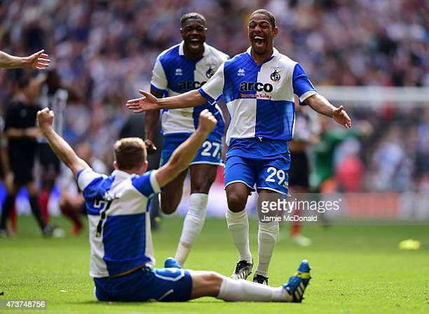 Angelo Balanta of Bristol Rovers runs to celebrate with Lee Mansell of Bristol Rovers after scoring the winning penalty in the shoot out during the...