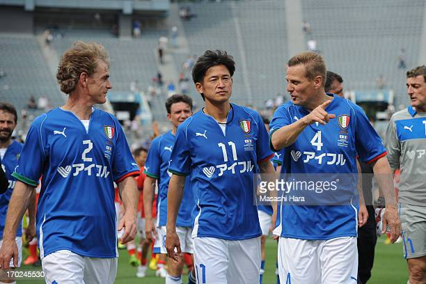 Angelo Colombo and Kazuyoshi Miura Roberto Mussi look on after the JLeague Legend and Glorie Azzurre match at the National Stadium on June 9 2013 in...