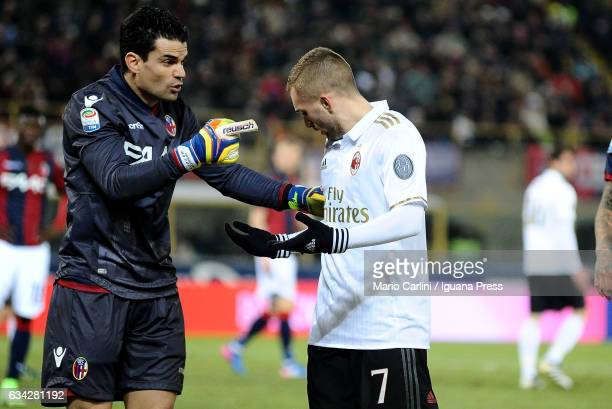 Angelo Da Costa goalkeeper of Bologna FC argues with Gerard Deulofeu of AC Milan during the Serie A match between Bologna FC and AC Milan at Stadio...
