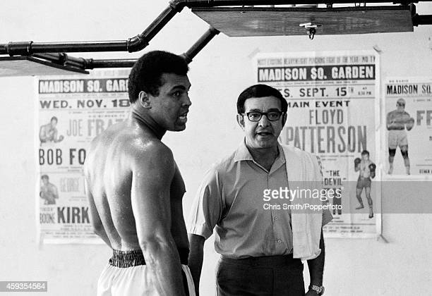Angelo Dundee and Muhammad Ali during a training session at Chris Dundee's 5th Street Gym in Miami Beach circa February 1971 Photo by Chris...