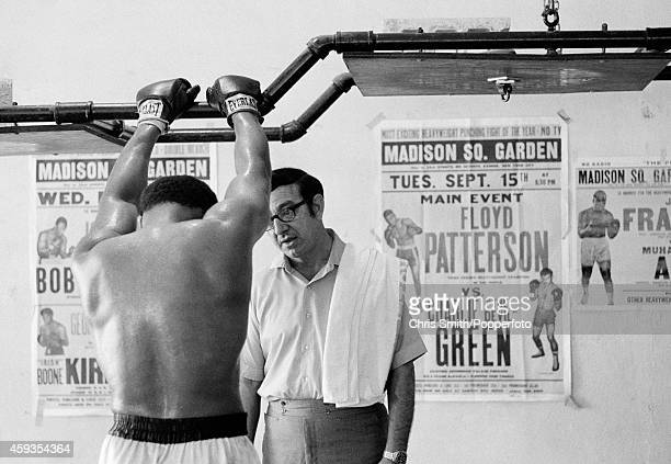 Angelo Dundee talking to Muhammad Ali during a training session at Chris Dundee's 5th Street Gym in Miami Beach circa February 1971 Photo by Chris...