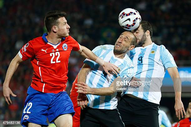 Angelo Enriquez of Chile goes for a header with Pablo Zabaleta and Gonzalo Higuain of Argentina during the 2015 Copa America Chile Final match...