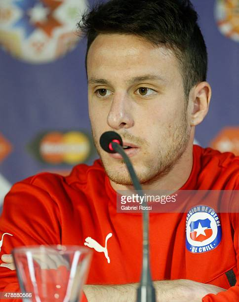 Angelo Enriquez of Chile talks during a press conference prior to the semi final match against Peru at Nacional Stadium as part of 2015 Copa America...