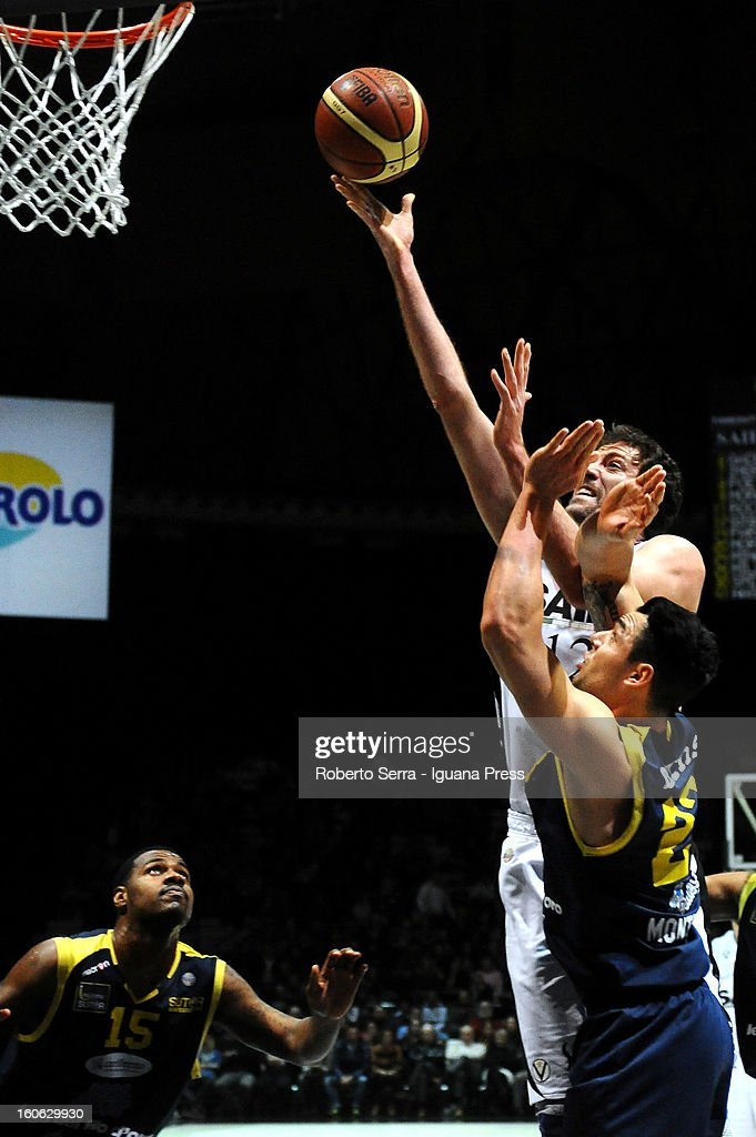 Angelo Gigli of SAIE3 competes with Christian Burns of Sutor during the LegaBasket Serie A match between Virtus Bologna SAIE3 and Sutor Montegranaro at Unipol Arena on February 3, 2013 in Bologna, Italy.