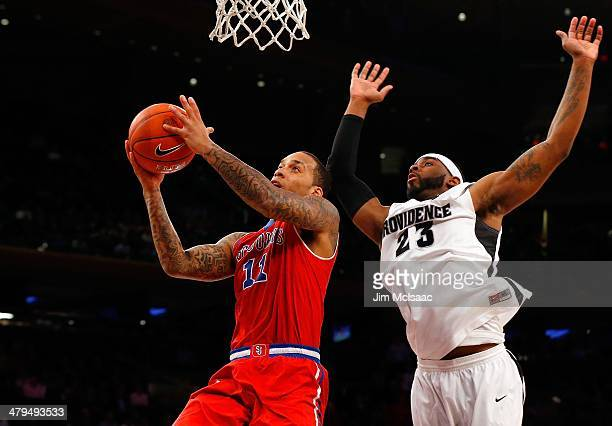 Angelo Harrison of the St John's Red Storm in action against LaDontae Henton of the Providence Friars during the quarterfinals of the Big East...