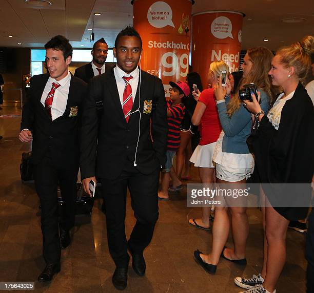 Angelo Henriquez Bebe and Anderson of Manchester United arrive in Stockholm ahead of their preseason friendly match against AIK Fotbol on August 5...