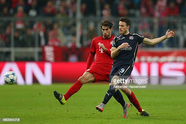 Angelo Henriquez of Dinamo Zagreb is challenged by Javi Martinez of Bayern Muenchen during the UEFA Champions League Group F match between FC Bayern...