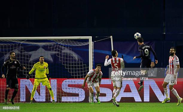 ZAGREB CROATIA OCTOBER 20 Angelo Henriquez of Dinamo Zagreb jump for the ball near Luka Milivojevic of Olympiacos FC during the UEFA Champions League...
