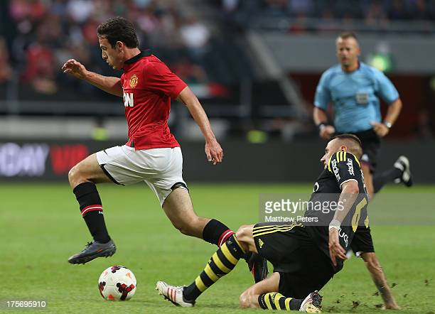 Angelo Henriquez of Manchester United in action with Alexander Milosevic of AIK Fotboll during the preseason friendly match between AIK Fotboll and...
