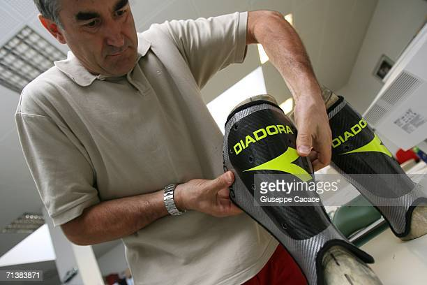 Angelo Mason head of Diadora's Research and Development department tests the carbon fibers of Francesco Totti's specially made shinguards to prevent...