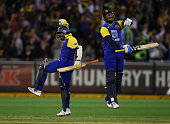 Angelo Mathews and Muttiah Muralitharan of Sri Lanka celebrate after after Sri Lanka defeated Australia during the Commonwealth Bank Series match...