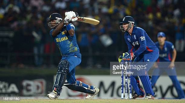 Angelo Mathews of Sri Lanka bats watched by England wicketkeeper Jonathan Bairstow during the ICC World Twenty20 2012 Super Eights Group 1 match...