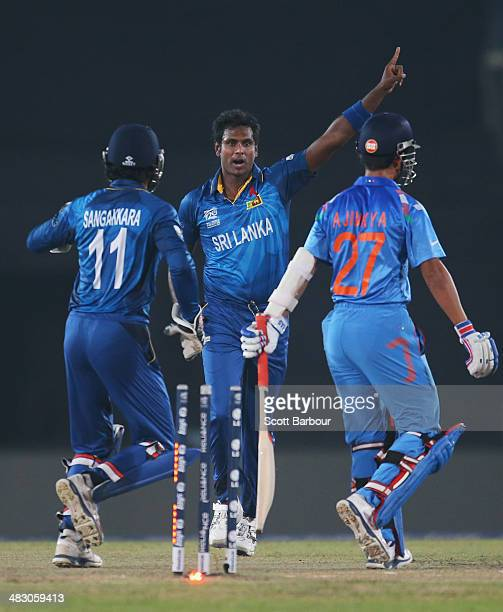 Angelo Mathews of Sri Lanka celebrates after dismissing Ajinkya Rahane of India during the Final of the ICC World Twenty20 Bangladesh 2014 between...