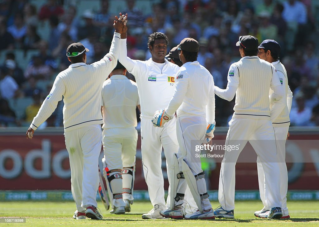 Angelo Mathews of Sri Lanka celebrates after dismissing David Warner of Australia during day one of the Second Test match between Australia and Sri Lanka at Melbourne Cricket Ground on December 26, 2012 in Melbourne, Australia.