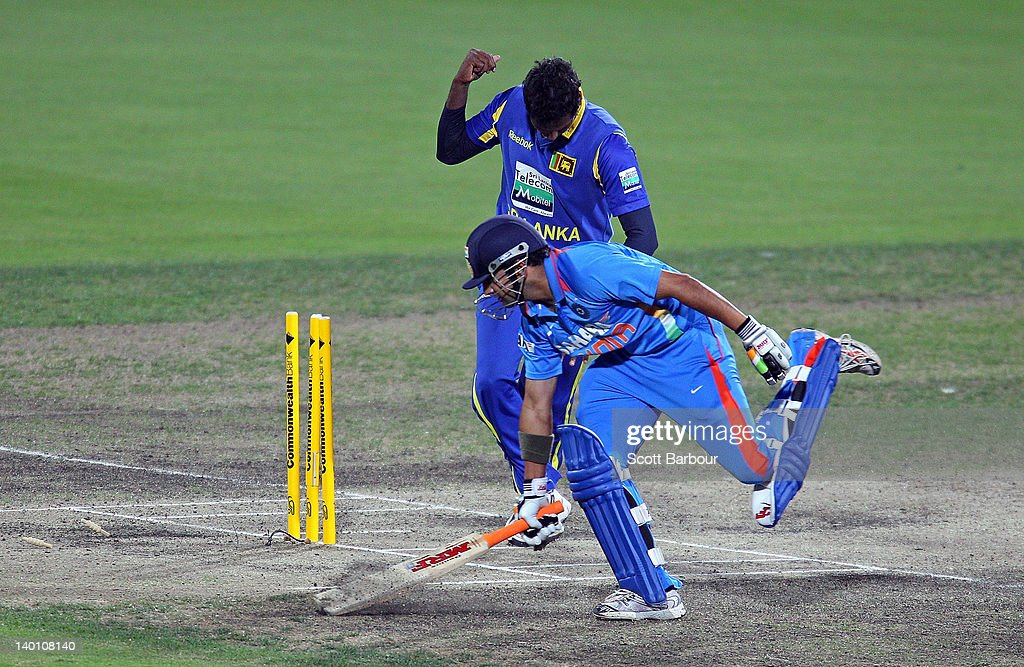 <a gi-track='captionPersonalityLinkClicked' href=/galleries/search?phrase=Angelo+Mathews&family=editorial&specificpeople=5622021 ng-click='$event.stopPropagation()'>Angelo Mathews</a> of Sri Lanka celebrates after running out <a gi-track='captionPersonalityLinkClicked' href=/galleries/search?phrase=Gautam+Gambhir&family=editorial&specificpeople=707703 ng-click='$event.stopPropagation()'>Gautam Gambhir</a> of India during the One Day International match between India and Sri Lanka at Bellerive Oval on February 28, 2012 in Hobart, Australia.