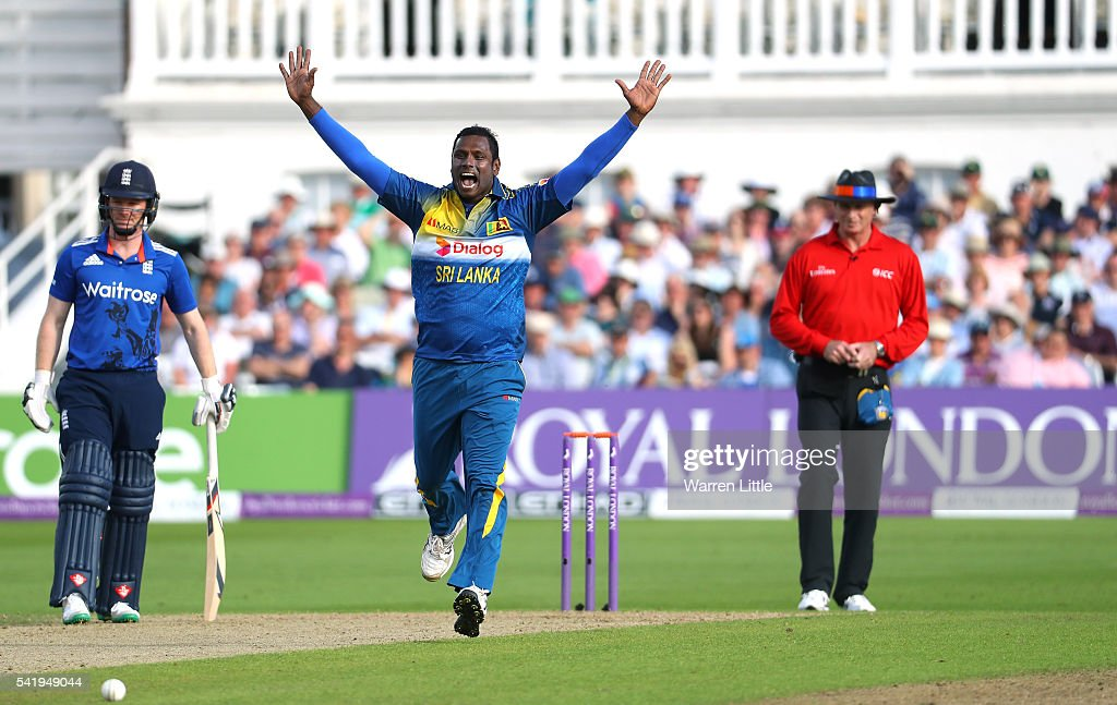 <a gi-track='captionPersonalityLinkClicked' href=/galleries/search?phrase=Angelo+Mathews&family=editorial&specificpeople=5622021 ng-click='$event.stopPropagation()'>Angelo Mathews</a> of Sri Lanka celebrates taking the wicket of Joe Root of England during of the 1st ODI Royal London One Day match between England and Sri Lanka at Trent Bridge on June 21, 2016 in Nottingham, England.
