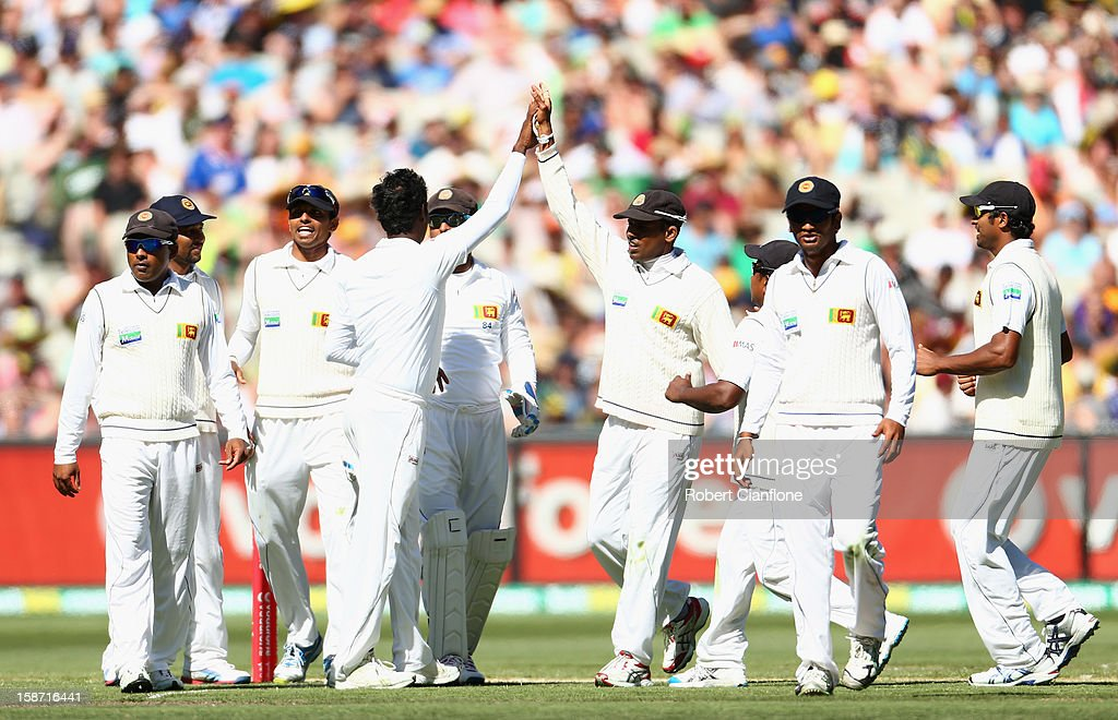 Angelo Mathews of Sri Lanka celebrates the wicket of David Warner of Australia during day one of the Second Test match between Australia and Sri Lanka at Melbourne Cricket Ground on December 26, 2012 in Melbourne, Australia.