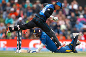Angelo Mathews of Sri Lanka dives into make his ground as Luke Ronchi of New Zealand runs through during the 2015 ICC Cricket World Cup match between...