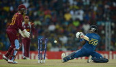 LANKA OCTOBER Angelo Mathews of Sri Lanka is bowled by Darren Sammy of the West Indies during the ICC World Twenty20 2012 Final between Sri Lanka and...
