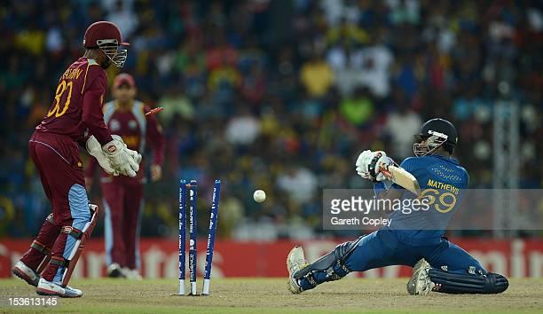 LANKA OCTOBER Angelo Mathews of Sri Lanka is bowled by Darren Sammy of the West Indies during the ICC World Twenty20 2012 Final between Sri Lanka and...