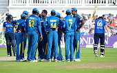 Angelo Mathews of Sri Lanka is congratulated after taking the wicket of Joe Root of England during of the 1st ODI Royal London One Day match between...