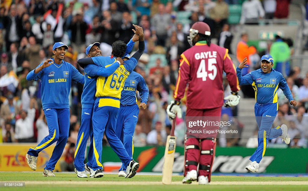 Angelo Mathews of Sri Lanka is mobbed by teammates after taking the wicket of Dwayne Bravo of West Indies as Chris Gayle of West indies looks on...