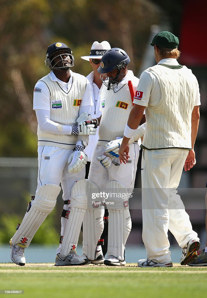 Angelo Mathews of Sri Lanka recovers after he was hit by a ball from Mitchell Starc of Australia during day five of the First Test match between Australia and Sri Lanka at Blundstone Arena on December 18, 2012 in Hobart, Australia.