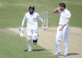Angelo Mathews of Sri Lanka runs past Liam Plunkett of England as he celebrates reaching his century during day four of 2nd Investec Test match...