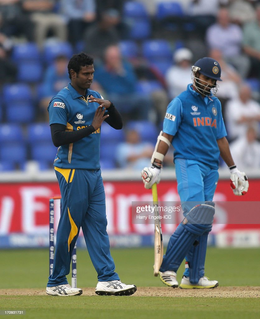 Angelo Mathews of Sri Lanka signals for a review during the ICC Champions Trophy Semi Final match between India and Sri Lanka at SWALEC Stadium on June 20, 2013 in Cardiff, Wales.