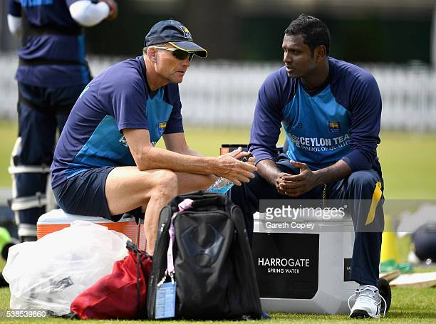 Angelo Mathews of Sri Lanka speaks with coach Graham Ford during a nets session ahead of the 1st Investec Test match between England and Sri Lanka at...